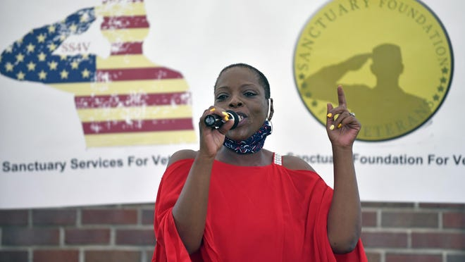 Sanctuary Foundation for Veterans founder and CEO Lashaunda Carter speaks during a ribbon-cutting ceremony for the foundation's veteran's home and service center in Willingboro on Friday.
