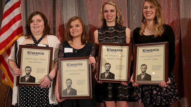 The top winners of the Abe Lincoln Award — Ashley McWhirter (from left), Hayley Faucett, Madisan Johnson and Victoria Updike — hold their plaques to be photographed following a ceremony Thursday at Downtown's Sheraton Indianapolis City Centre Hotel.