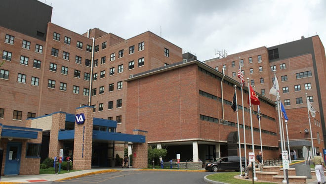 This Aug. 25, 2011, file photo shows the Veterans Administration Medical Center in Syracuse, N.Y. The Associated Press analyzed six months of appointment data at 940 VA hospitals and clinics nationwide from September 2014 to February 2015; in New York, three of the facilities with the highest rates of delays of more than 30 days are in an area of upstate New York operated from the Syracuse VA Medical Center