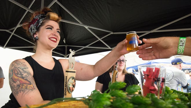 Jessica Besecker with Fordham Brewery serves their spiced harvest beer at the Delaware Wine and Beer Festival at the Delaware State Fairgrounds in Harrington in October. Kent County unveiled its new branding campaign that it hopes will increase visitor spending.