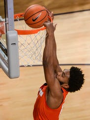 Clemson guard Gabe DeVoe (10) dunks against Georgia