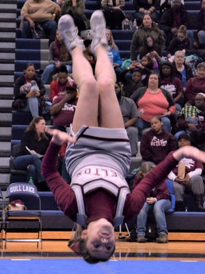 Delton Kellogg's Savannah Chilton performs a back tuck during the Gull Lake Invitational on Jan. 13, 2018.