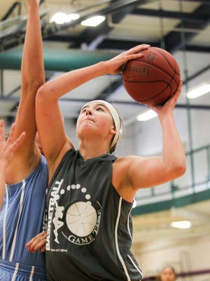 Incoming Iowa freshman Megan Gustafson drives to the hoop during her team's Game Time League game at the North Liberty Community Center on Wednesday.
