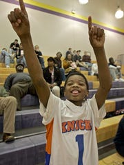 Hoover point guard Khallid Edwards at age 11 wearing his Des Moines Knicks jersey.
