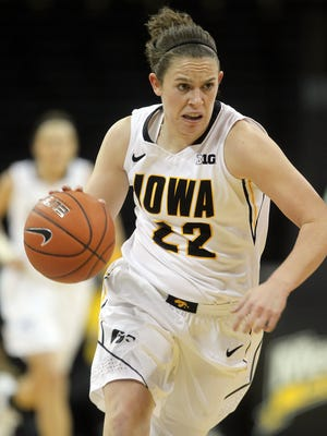 Iowa's Samantha Logic takes the ball down court during the Hawkeyes' game against USC Upstate at Carver-Hawkeye Arena on Friday, Nov. 14, 2014. David Scrivner / Iowa City Press-Citizen