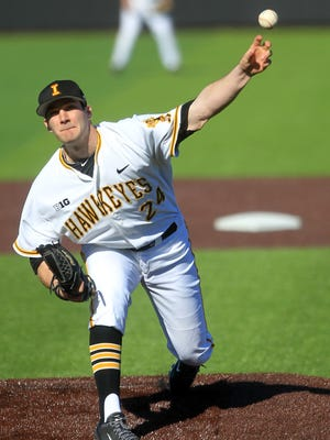Iowa's Nick Allgeyer throws a pitch during the Hawkeyes' game against AIB at Duane Banks Field on Wednesday. Allgeyer recorded the win for Iowa, one of nine pitchers to take the mound.