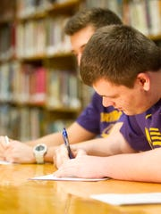 Regina's Phil Arendt signs his letter of intent to UNI at Regina on Wednesday, Feb. 4, 2015.