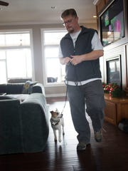 """Bryan Dover leads Sammi, a Jack Russell terrier who stars in Joe Clarke's upcoming film, """"Up on the Wooftop,"""" in a scene in Iowa City on Tuesday."""