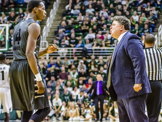 Oakland coach Greg Kampe (right) has few words for