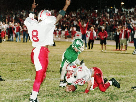 120-2-1995 1a; TAMPA--Charles Williams, left, celebrates as Brandon Rimes scores the second touchdown of the first quarter past the coverage of Tampa Catholic's #44, Rico Martinez. photo by: Benjamin Rusnak/NEWS-PRESS