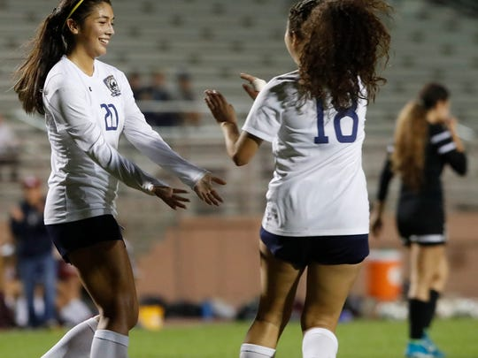 Monica Calderon, of La Quinta High School celebrates her goal with team mate Marcela Gallo after scoring against Cathedral City High School.