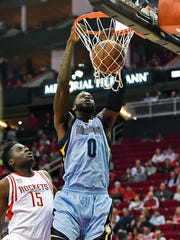 Memphis Grizzlies forward JaMychal Green (0) dunks as Houston Rockets center Clint Capela (15) looks on in the first half of an NBA basketball game, Saturday, March 4, 2017, in Houston.
