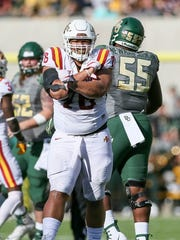 Iowa State Cyclones defensive lineman Ray Lima (76) celebrates a tackle against the Baylor Bears at McLane Stadium in 2017.