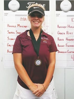 Eldon's Kassidy Hull is all smiles after capturing her third straight conference title on Monday, September 28, at Eldon Golf Club.