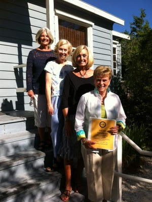 Board members Ellen O'Neill, Dorothy Donaldson, Gayle Pence, and Jan Halliday worked on a new, updated Docent Handbook, an invaluable tool full of information about Sanibel history.