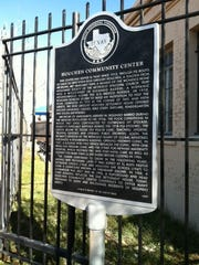 A historical marker is shown at the Houchen Community Center.