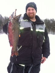 Jake Holstrom with this big brook trout taken through the ice in the Hayward area.