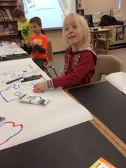 Kindergartners at Hatley Elementary learn about coding.