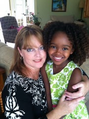 Kim (left) and Lidya Jewett will live in Atlanta for