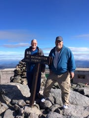 Gary Littlefield and Gary Smith enjoy the view at Mount Washington in New Hampshire.