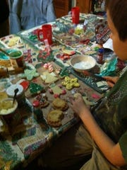 Barbara Bell-Kicinski, of Binghamton, and her family host a cookie night in place of a gift swap for the adults in the family.