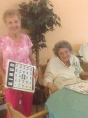EL-DOE Ruth Webster, left, plays Bingo with a Pelican Garden resident.
