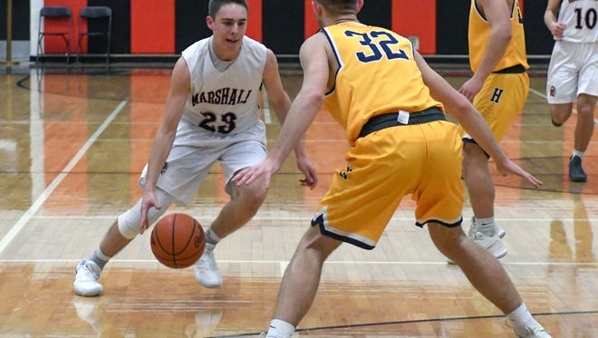 Marshall's Jack Crull (23) drives the court during game action Tuesday night.