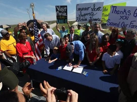 Gov. Rick Scott signed a bill to build a water storage