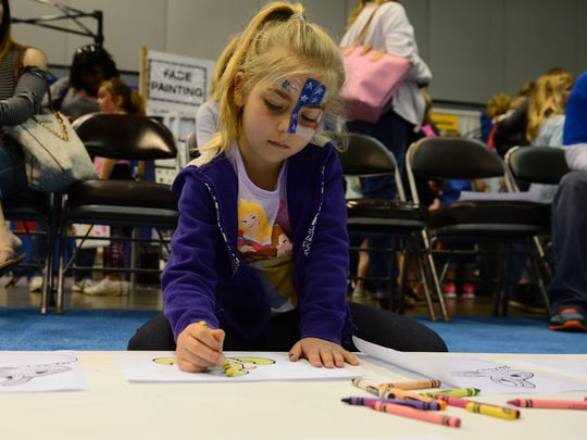 Sophia Sharpe, of Lancaster, Pa., colors during the