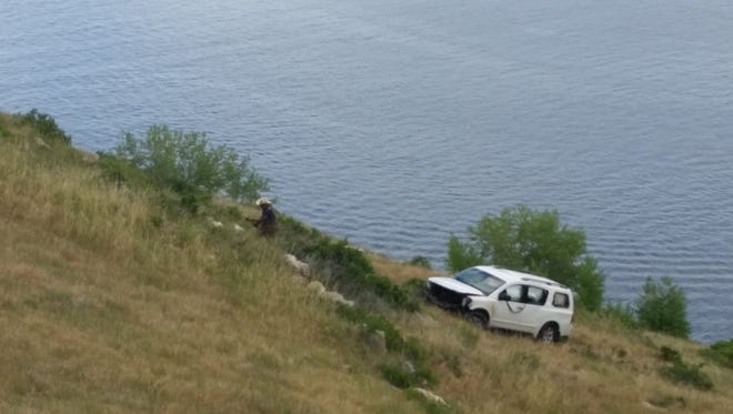Crews work Tuesday to pull a car from Horsetooth Reservoir. The car was found submerged in the reservoir Monday night, but rescue crews did not find any people in the car or water.