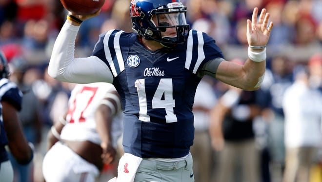 Ole Miss quarterback Bo Wallace passes against Alabama on Saturday in the Rebels' 23-17 win. Wallace threw for 251 yards and three touchdowns.