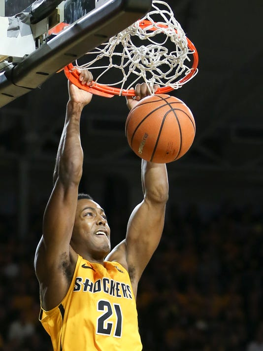 Wichita State forward Darral Willis Jr. dunks against Arkansas State during the first half of an NCAA college basketball game, Tuesday, Dec. 19, 2017 in Wichita, Kan. (Travis Heying/The Wichita Eagle via AP)