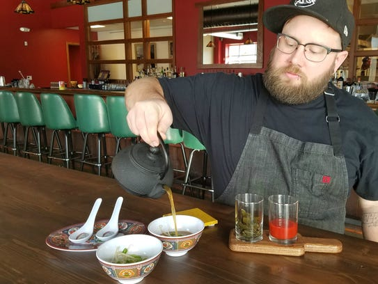 LongBranch chef Adam Ditter's pours  bone broth over