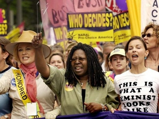 Actors Camryn Manheim (from far left), Cybill Shepherd, Whoopi Goldberg, Ashley Judd and Christine Lahti (behind Judd), march in Washington, D.C., on April 25, 2004, during an abortion-rights rally. Shepherd and Goldberg waved hangers.