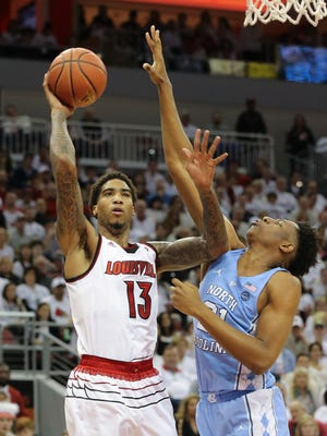 U of L's Ray Spalding (13) shot against against North Carolina's Sterling Manley (21) during their game at the Yum Center.    Feb. 17, 2018