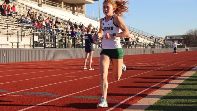 Aubrey O'Connell of Prosper High School competes in the 3200-meter race at the McKinney ISD Relays held at Ron Poe Stadium in February..