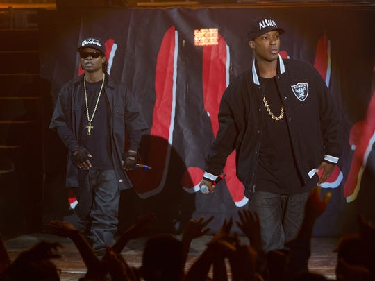 Eazy-E (Mitchell) and Dr. Dre (Hawkins) take the stage,