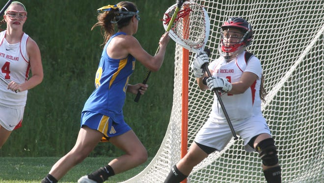 Mahopac's Kim Harker scores past North Rockland goalie Gianna Guerra during their lacrosse sectional semifinal at North Rockland May 19, 2015. Mahopac won 11-6.
