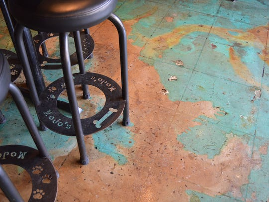 MoJos' floors were treated with a copper and turquoise