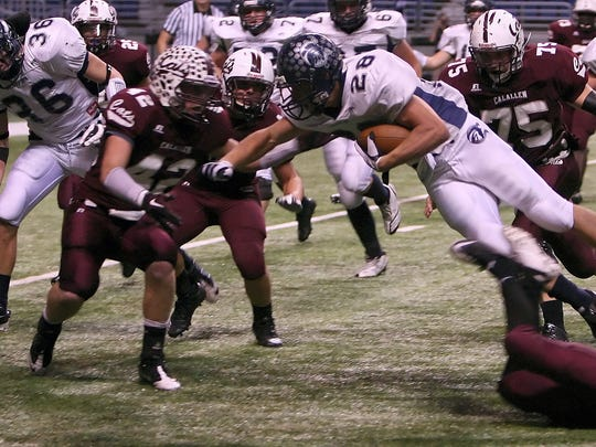 Members of the Calallen Wildcats defenses stop Boerne Champion Chargers David Rogers at the 4-yard line during the second quarter of Friday state quarterfinals game.