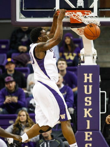 Washington forward Shawn Kemp, Jr. dunks against Grambling