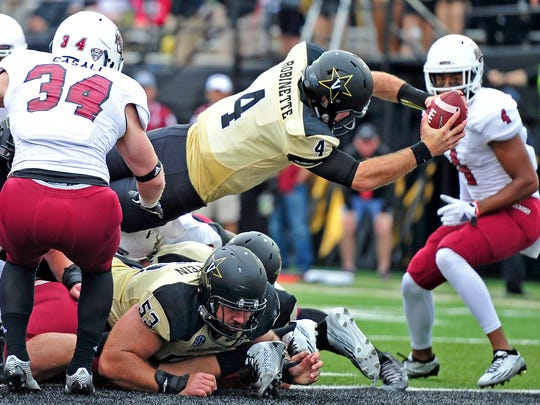 Vanderbilt quarterback Patton Robinette (4) dives in for a touchdown against Massachusetts during the second quarter in Nashville, Tenn., Saturday, Sept. 13, 2014.
