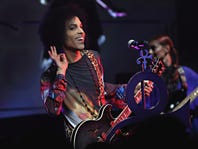 """Cindy Ord,  Getty Images, Prince performs onstage with 3RDEYEGIRL during their """"HITnRUN"""" tour at Sony Centre For The Performing Arts in 2015."""