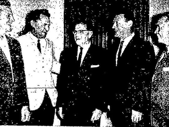 Swiss diplomat Erich Messmer (center), the counsel-general for Switzerland stationed in New Orleans, is pictured with County Commissioner Jack Dritenbas, Mayor Robbie Allison, Bob Eglin, and Councilman Fred Prestin. Allison is the only one pictured without Swiss ancestry. (Feb. 23, 1957)
