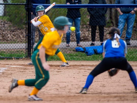 BFA's Meghan Connor, left, takes a pitch as May Gratton,
