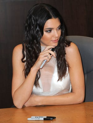 """Kendall Jenner signs her debut novel """"Rebels: City of Indra: The Story of Lex and Livia"""" at Barnes & Noble bookstore at The Grove on June 12, 2014, in Los Angeles."""