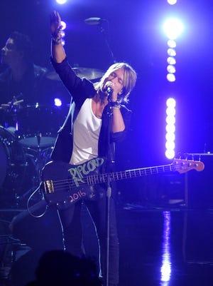 "Keith Urban performs ""John Cougar, John Deere, John 3:16"" at the 49th Annual CMA Awards Wednesday Nov. 4, 2015, in Nashville, Tenn."