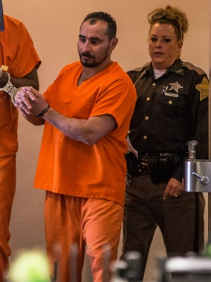Manuel Orrego-Savala, charged with two counts of failure to remain at the scene of an accident, a Level 3 felony, and two counts tied to drunken driving death, a Level 4 felony, walks out of the courtroom at the City-County Building on Wednesday, Feb. 7, 2018. Wearing orange jail garb, he appeared in Marion Superior Court on Wednesday morning for an initial hearing.