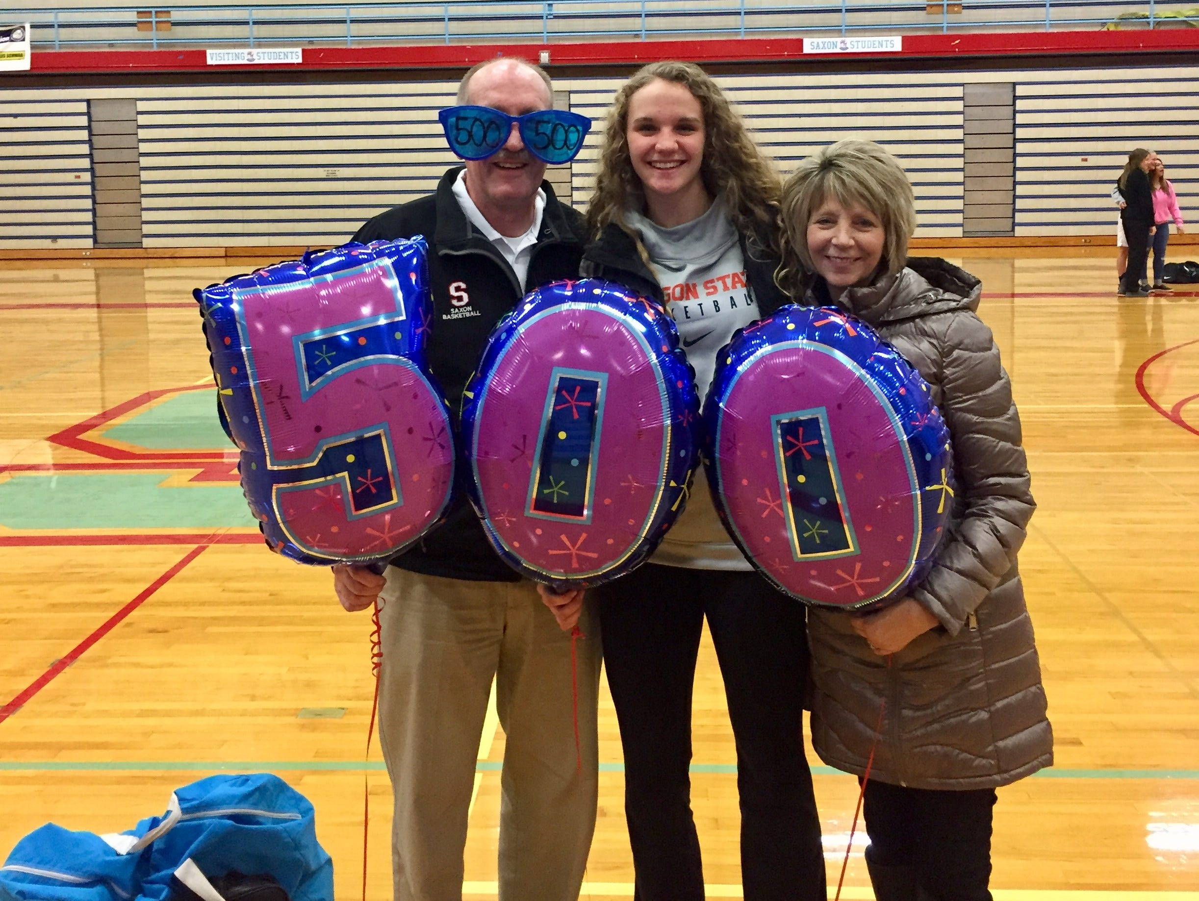 South Salem girls basketball coach Nick McWilliams (left) poses with daughter Katie (middle) and wife Diane after he won his 500th game as a head coach.