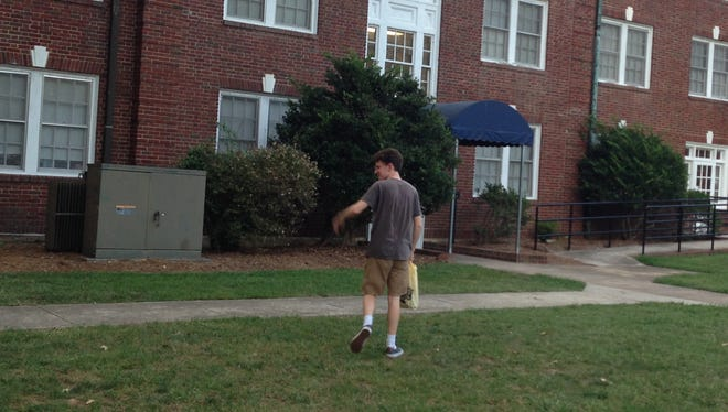 The Boy waves us away as he enters his dorm, leaving the nest to become a college freshman.
